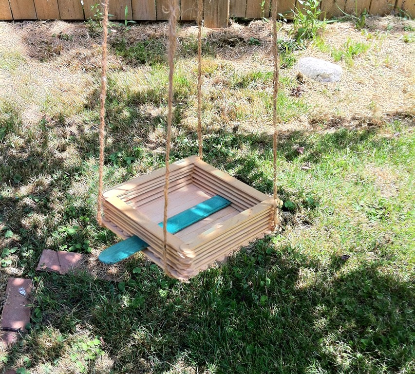An easy to make bird feeder craft made of popsicle sticks