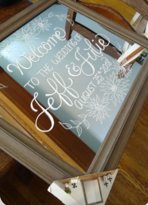 Welcome mirror wedding sign with text saying Welcome to the wedding of Jeff & Julie August 25 2018