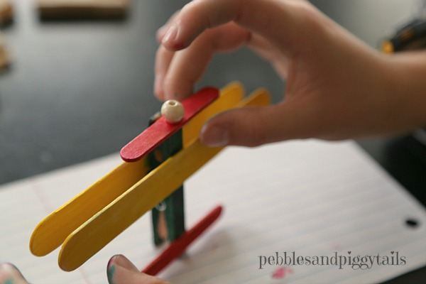 A fun, exciting, and easy to make popsicle stick airplane craft for kids