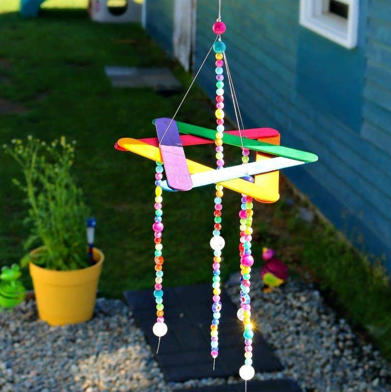 A cute and easy to make wind chime made of popsicle stick perfect for the garden and kids craft