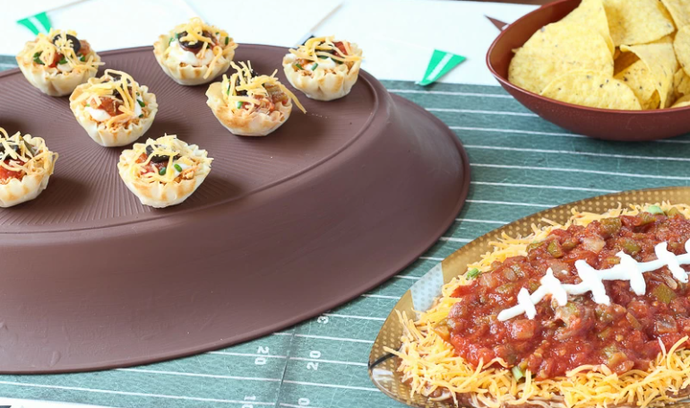 Chicken Taco bites sprinkled with shredded cheese