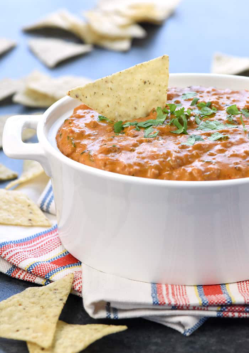 Hot taco dip served with tortilla chips