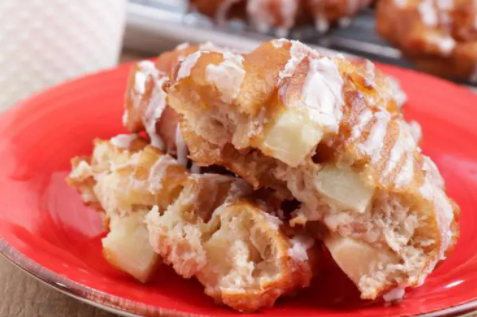 Scrumptious apple fritters drizzled with blended powdered sugar and milk