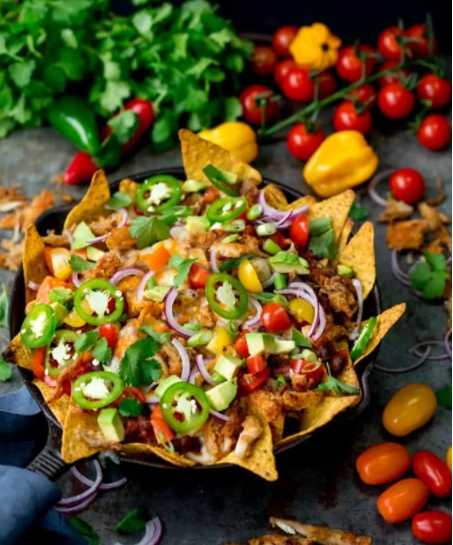 Crispy turkey nachos with garlicky passata, some avocado, tomatoes, red onion, jalapenos and melted cheese